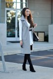 Blogger in Grey Tailored Sleeveless Jacket